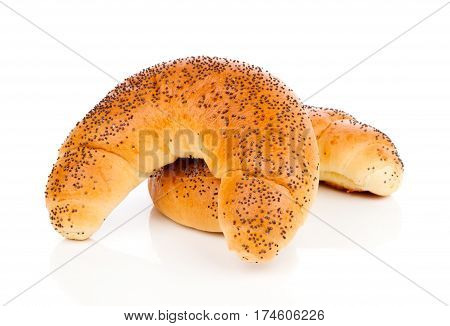 Bun with poppy seeds isolated on white background