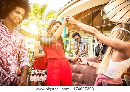 Friends dancing in a lounge bar with dj set