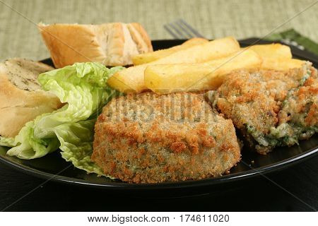 vegetarian cheese and vegetable bakes with salad and fries