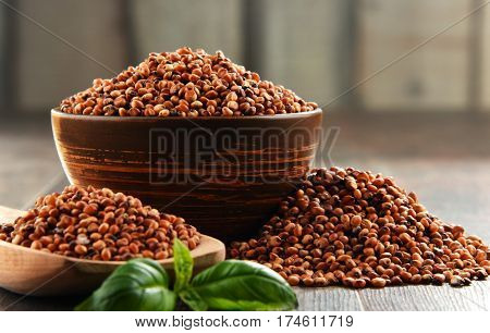 Composition with bowl of sorgo grain on the table