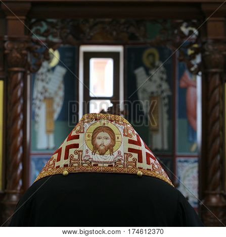 Orthodox bishop praying in front of altar