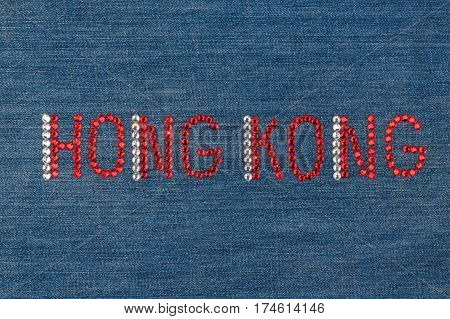 Inscription Hong Kong inlaid rhinestones on denim. View from above