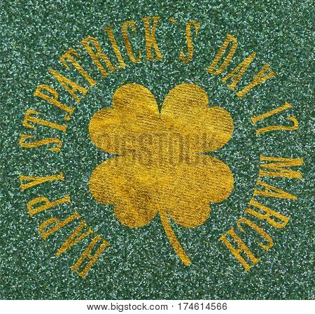 Gold Clover with four leaves on glittery green background Happy St. Patrick's Day 17 march