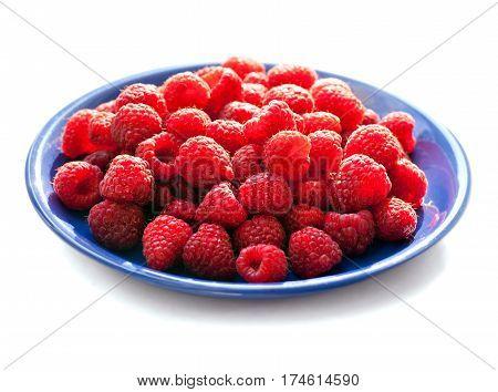 Big Pile of Fresh Raspberries isolated on White Background