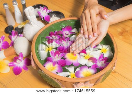 Woman Hands With A Bowl Of Aroma Spa Water Salt