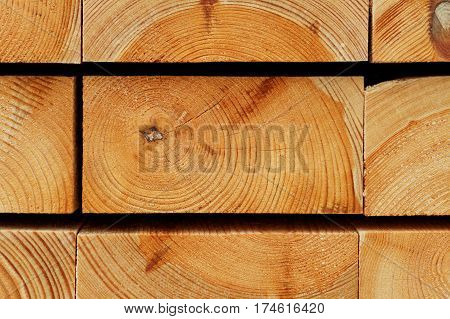 Timber Background: Annual Rings Texture of Piled Pine Construction Boards