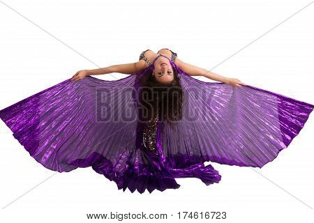 Dancer in a silver suit with purple wings isolated on white background