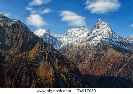 Landscape of mountains Caucasus region in Russia Mountain peaks in clouds. Caucasus. Dombay.