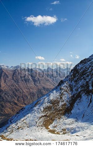 Landscape of mountains Caucasus region in Russia Mountain peaks in clouds. Caucasus. Dombay.