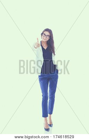 Portrait of a beautiful young woman showing ok, isolated on white background