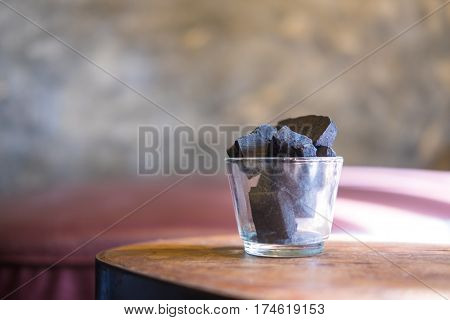 Charcoal arranged in a glass vase. Acts deodorizer which increase negative ions and purifies air