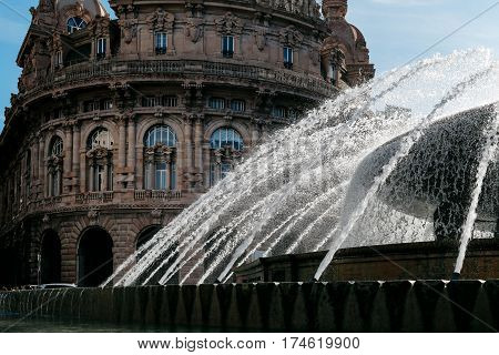 GENOA, ITALY - OCTOBER 31, 2016: Fountain in main square of the city, Piazza De Ferrari, which was restored in recent years along with a major restyling of the square.