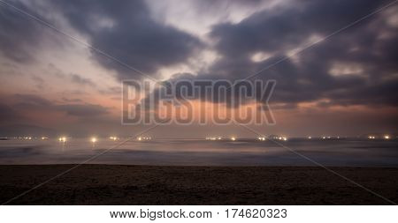 Lights of shrimp farming rigs in Vung Lam Bay Vietnam just before sunrise looking out over the south China sea.