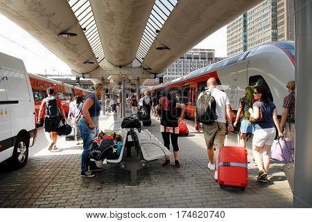 Oslo Norway - July 22 2014: Unidentified passengers at the central railway station of Oslo also called