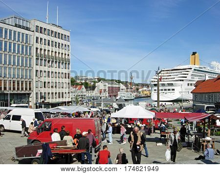 Stavanger, Norway - June 5, 2009: People shopping in the market square at the Vagen Harbour in Stavanger (Norway).