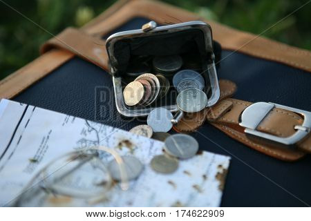 old coins in the purse in the field