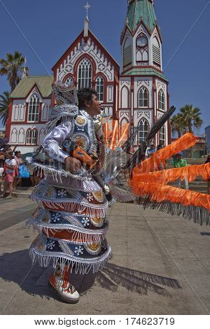 ARICA, CHILE - FEBRUARY 10, 2017: Male member of a Morenada Dance Group dressed in ornate costume performing during a street parade at the annual Andean Carnival in Arica, Chile