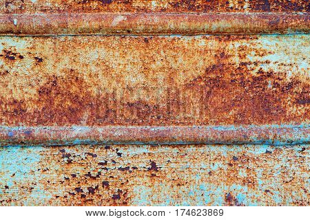 Plate of metal rusty on all background, with old layers of a pai