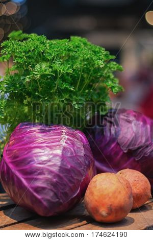 Sweet potato red cabbage and parsley displayed on the food festival.