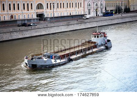 Old barge floats down the Moscow-river, Russia