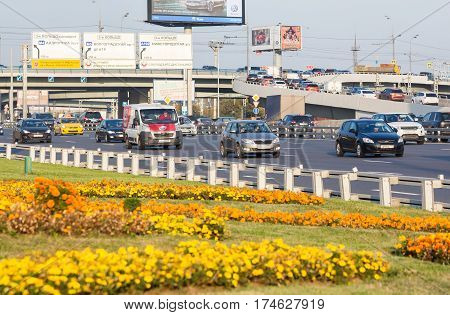 MOSCOW - SEPTEMBER 23 2015: A view to theThird Ring Road from flowerbed. This highway is the newest beltway in the city always full of vehicles.