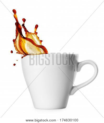 small classical white cup of coffee espresso with splash isolated on white background. Coffee splash from a cup