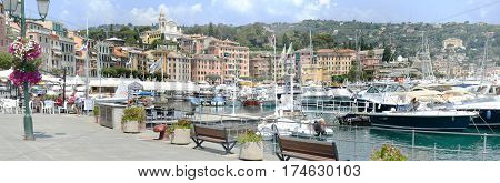 S.Margherita Ligure Italy - 9 July 2015: People eating and drinking on a restaurant at the promenade of S.Margherita Ligure famous small town in Liguria Italy near Portofino