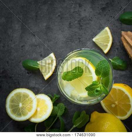 Refreshment drink lemonade. Traditional Summer drink with lemon mint and ice. Top view.