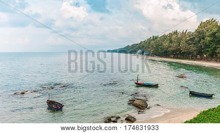 sea in the morning sunrise with cloudy sky and small fishing boat rayong province thailand