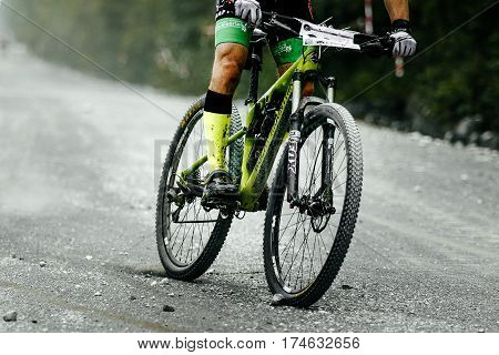 V.Ufaley Russia - August 09 2015: racer cyclist mountainbiker downhill on gravel road during bicycle race