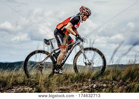 V.Ufaley Russia - August 09 2015: mountainbiker cyclist rides on trail top of mountain during bicycle race