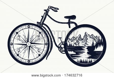 Bicycle tattoo art. Symbol of travel tourism adventure. Compass and mountains in bicycle wheels t-shirt design