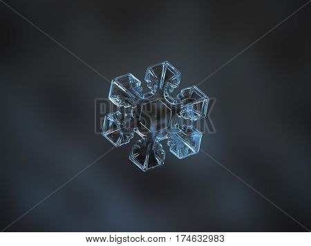 Macro photo of real snowflake: medium size, transparent snow crystal with short and broad arms, large central hexagon with simple pattern and perfect hexagonal symmetry, glittering on dark blue blur background.