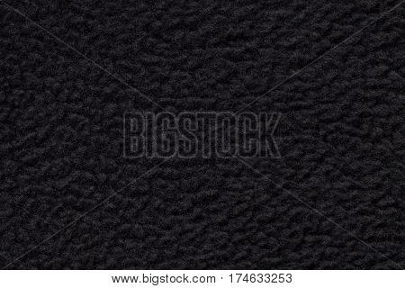 Black suede fabric closeup. Velvet texture background