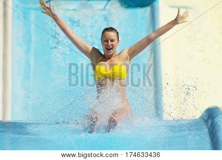 Woman Sliding Down On Water-slide In Aqua Park.