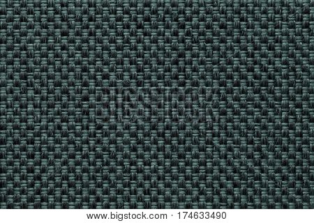 Dark green background with checkered pattern closeup. Structure of the fabric macro.