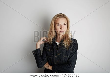 Portrait of beautiful woman smiling. Posing infront of empty background.