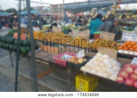 blurred photo Blurry image Vendors selling fruits and vegetables at the Market Street corridorbackground