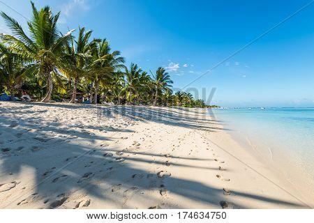 Le Morne Mauritius - December 11 2015: Amazing white beaches of Mauritius island. Tropical vacation in Le Morne Beach Mauritius one of the finest beaches in Mauritius.