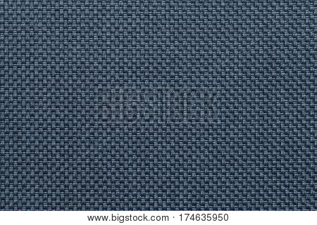 Navy blue textile background closeup. Structure of the fabric macro.