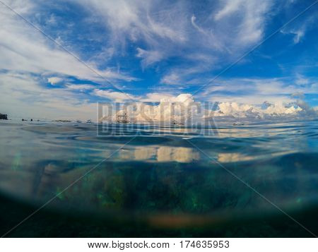 Marine landscape with transparent water and blue sky. Natural water background. Summer beach landscape sea water. Blue sea water look through. Summer vacation on the beach seaside view to sea