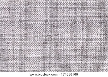 Light gray textile background closeup. Structure of the fabric macro.