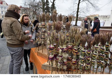 VILNIUS LITHUANIA - MARCH 4: Unidentified people trade traditional palm bouquets in annual traditional crafts fair - Kaziuko fair on Mar 4 2017 in Vilnius Lithuania