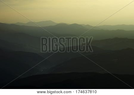 Mountain landscape just before sunrise. Tonal perspective.