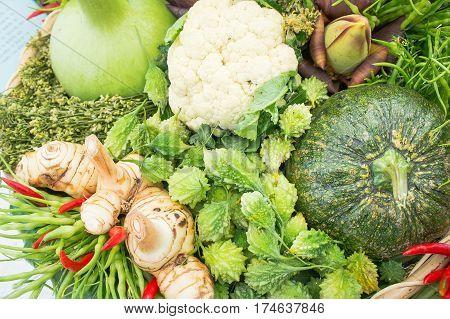 Bitter gourd pumpkin galangal herbs Thailand vegetables raw healthy eating