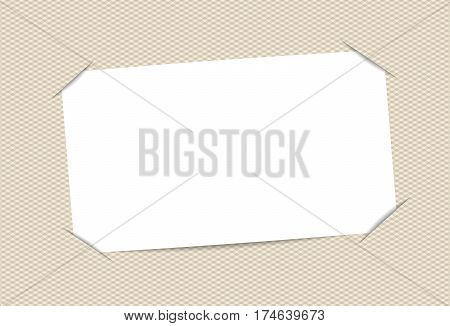 Blank, white paper card inserted into squared brown background.
