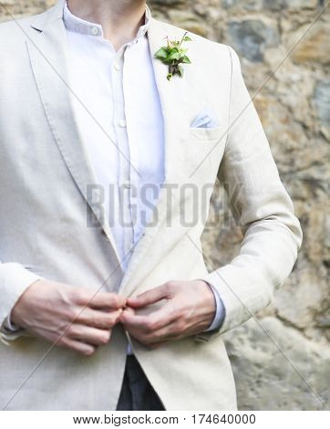 Gentle groom boutonniere with ivy. Close up