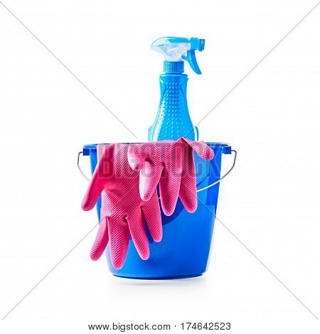 Bucket with cleaning supplies and pink gloves isolated on white background. Single object with clipping path