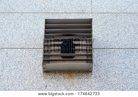 Ventilation grille on granite wall of modern building. Facade element