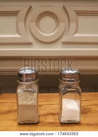 salt and pepper on the table in the restaurant with blur background salt and pepper powder for seasoning main dish back pepper for meal
